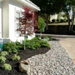 is mulch or rock better for landscaping